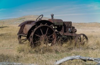 A wonderful old tractor at its final resting place. Look close and you can see that a long time ago it was green.